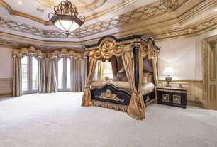 Traditional Master Bedroom with Crown molding, Wainscotting, French doors, Carpet, Chandelier