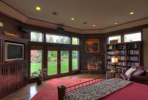 Craftsman Master Bedroom with Fireplace, Built-in bookshelf, French doors, Standard height, Transom window, Cement fireplace