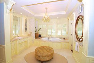 Traditional Master Bathroom with Raised panel, Chandelier, Limestone counters, limestone floors, Glass panel, Crown molding