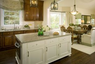 Traditional Kitchen with Pendant light, Flat panel cabinets, European Cabinets, Simple granite counters, full backsplash