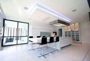 Contemporary Kitchen with Blu Dot Counterstool, electric cooktop, can lights, specialty door, European Cabinets, L-shaped