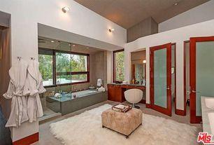 Modern Master Bathroom with Rain shower, Inset cabinets, frameless showerdoor, limestone tile floors, Slate counters