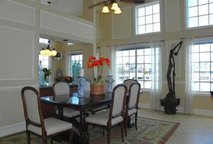 Traditional Dining Room with Concrete tile , flush light, Ceiling fan, Cathedral ceiling, Chair rail