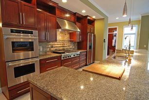 Modern Kitchen with Simple granite counters, can lights, Crown molding, electric cooktop, One-wall, double wall oven
