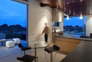 room with Soapstone counters, Pendant light, L-shaped, specialty door, High ceiling, limestone tile floors, flush light