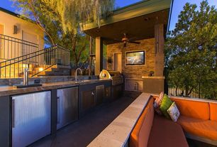 Contemporary Patio with Outdoor kitchen, exterior tile floors