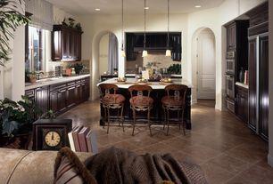 Traditional Kitchen with Kitchen island, limestone tile floors, Undermount sink, Custom hood, Breakfast bar, Raised panel