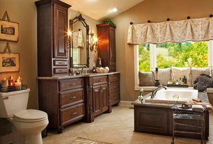 Traditional Master Bathroom with limestone tile floors, flush light, Wall sconce, Raised panel, Undermount sink, Window seat