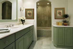Traditional Master Bathroom with Flush, Raised panel, Corian counters, Wall sconce, limestone tile floors, Undermount sink
