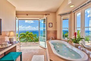 Tropical Master Bathroom with Flush, stone tile floors, Wall Tiles, drop in bathtub, Casement, Bathtub, Standard height