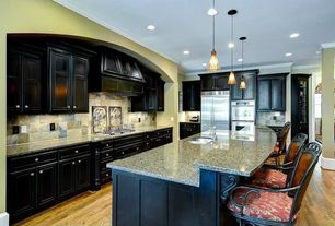 Traditional Kitchen with Kitchen island, Flush, Standard height, Stone Tile, Custom hood, Glass panel, Hardwood floors