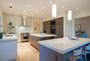 """Contemporary Kitchen with 12-1/2 in. stainless-steel finish bar pull, White quartz countertop in """"snowstorm"""", Breakfast bar"""