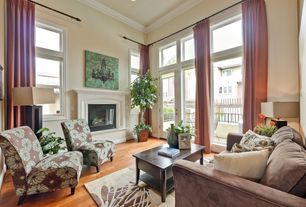 Traditional Living Room with French doors, High ceiling, metal fireplace, Hardwood floors, can lights, double-hung window