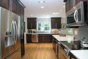 Modern Kitchen with Undermount sink, Lush fog bank 1x2 glass subway tile, Flat panel cabinets, Subway Tile, flush light