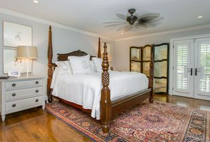 Traditional Master Bedroom with French doors, Oriental rug, Paint, Ceiling fan, Hardwood floors, Crown molding, can lights