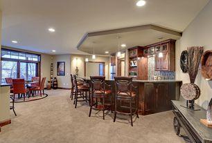 Craftsman Bar with Bar stool, Built-in bookshelf, Glass mosaic tile backsplash, can lights, Paint, Standard height, Carpet
