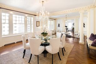 Traditional Dining Room with Crown molding, Chandelier, Hardwood floors, Columns