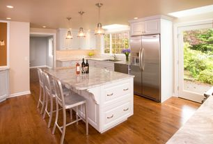 Traditional Kitchen with Eureka danby marble, Cone 1-light pendant, Delta bar stools
