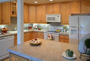 Traditional Kitchen with Inset cabinets, Kitchen island, limestone tile floors, Glass panel, Columns, L-shaped, Stone Tile