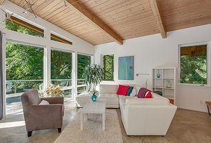 Contemporary Living Room with Exposed beam, limestone tile floors, Built-in bookshelf, flush light