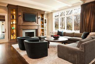 Traditional Living Room with French doors, Hardwood flooring, Hardwood floors, Built-in bookshelf, Box ceiling, Crown molding