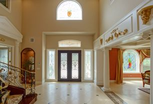 Traditional Entryway with Arched window, Columns, Stained glass window, High ceiling, French doors, Transom window