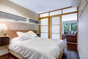 Contemporary Master Bedroom with Hardwood floors, Standard height, Paint 1, sliding glass door, Transom window