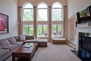 Traditional Living Room with Wall mounted tv, Crate & Barrel Frame Large Coffee Table, Carpet, Arched window, High ceiling