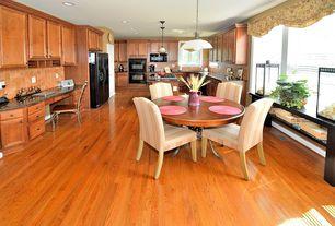 Craftsman Kitchen with Kitchen desk, Inset cabinets, Stone Tile, Raised panel, Breakfast nook, Undermount sink, U-shaped