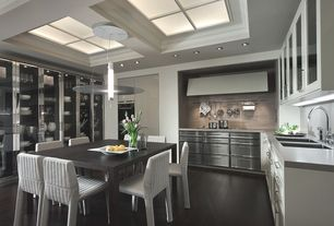 Contemporary Kitchen with Undermount sink, Custom hood, Flat panel cabinets, Stainless Steel, Skylight, Pendant light, Flush