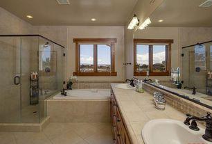 Craftsman Master Bathroom with wall-mounted above mirror bathroom light, Bathtub, Shower, Limestone tile counters, Casement