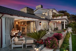 Traditional Patio with Raised beds, Gate, French doors, exterior stone floors, Pathway, exterior tile floors
