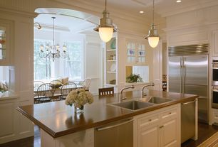 Traditional Kitchen with Raised panel, specialty door, Wall sconce, L-shaped, Flat panel cabinets, Pendant light, Bay window
