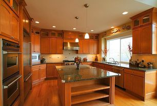 Traditional Kitchen with Simple granite counters, Kitchen island, Large Ceramic Tile, U-shaped, Pendant light, Glass panel