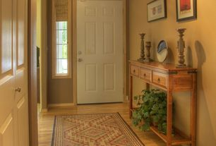 Traditional Entryway with six panel door, Paint, Hardwood floors, Standard height, Surya ventura green - red area rug, Carpet