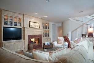 Traditional Living Room with Built-in bookshelf, stone fireplace, REBECCA TRUNK, Crown molding, Standard height, can lights