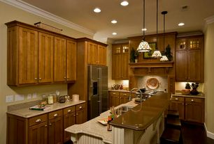 Craftsman Kitchen with Simple Granite, soapstone tile counters, Inset cabinets, Crown molding, Custom hood, Glass panel