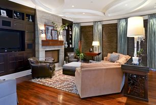 Eclectic Living Room with interior wallpaper, can lights, Fireplace, Hardwood floors, stone fireplace, Built-in bookshelf