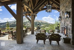 Country Patio with Outdoor living, Deck Railing, exterior stone floors, Exposed beam, Covered patio