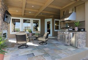Craftsman Porch with French doors, exterior stone floors, Outdoor kitchen