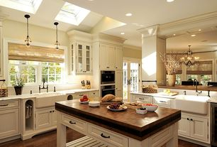 Traditional Kitchen with Complex marble counters, Kitchen island, Glass panel, Subway Tile, Roman blind, Farmhouse sink