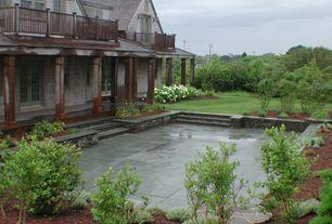 Cottage Patio with Raised beds, exterior concrete tile floors, French doors, Deck Railing, Casement, double-hung window