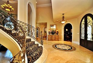 Mediterranean Entryway with French doors, sandstone tile floors, Butler artifacts console cabinet, Paint, Standard height