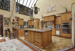"Mediterranean Kitchen with Custom hood, Skylight, U-shaped, Mullican Flooring Oak Gunstock 3/4"" Solid Wood 3 inch Wide"
