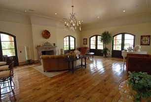 Eclectic Living Room with High ceiling, Hardwood floors, Crown molding, Chandelier, Cove molding, French doors