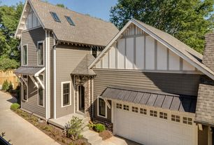 Traditional Exterior of Home with Fence, exterior tile floors, Skylight, Pathway, exterior awning