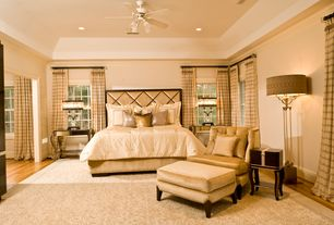 Traditional Master Bedroom with Ceiling fan, High ceiling, Crown molding, Hardwood floors