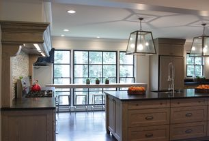 Contemporary Kitchen with Soapstone counters, Portnoy kitchen faucet with spring spout, Flat panel cabinets, Ceramic Tile