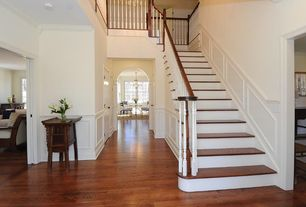 Traditional Staircase with Wainscotting, Hardwood floors, High ceiling, curved staircase