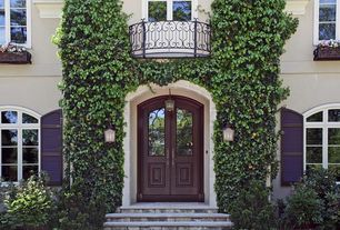Traditional Front Door with Raised beds, Arched window, Glass panel door, exterior stone floors, Pathway